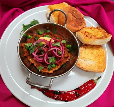 Mash potato and pea curry served with bread rolls